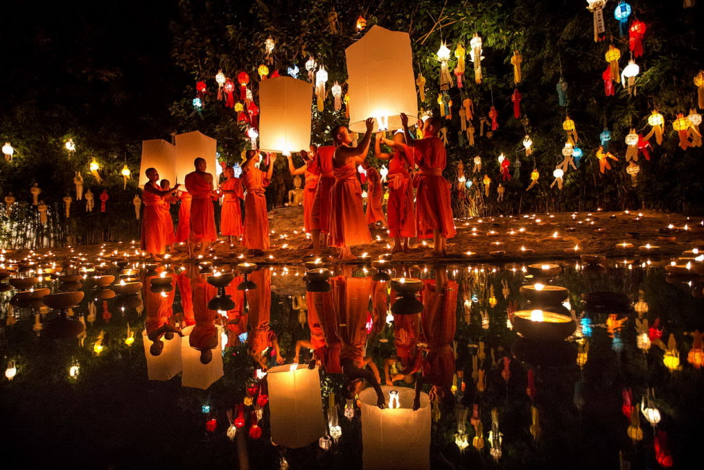 NOVEMBER 18: In this Nov. 17, 2013 photo, Buddhist monks prepare to release sky lantern after a blessing ceremony during the Loy Krathong Festival at a temple in Chiang Mai, Thailand. (Vincent Thian/Associated Press)
