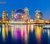 Blue hour captures the mulitcolored lights of False Creek's Science World in Vancouver, BC Canada